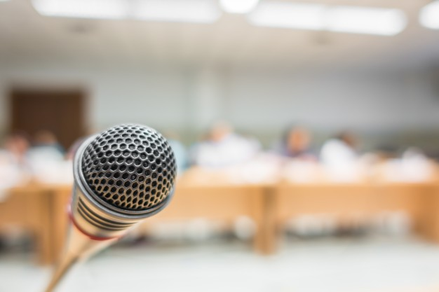 black-microphone-in-conference-room-filtered-image-processed-v_1232-2777